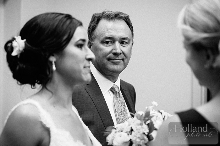 Dad looks at his daughter before the ceremony at L&R's Steamboat Springs wedding