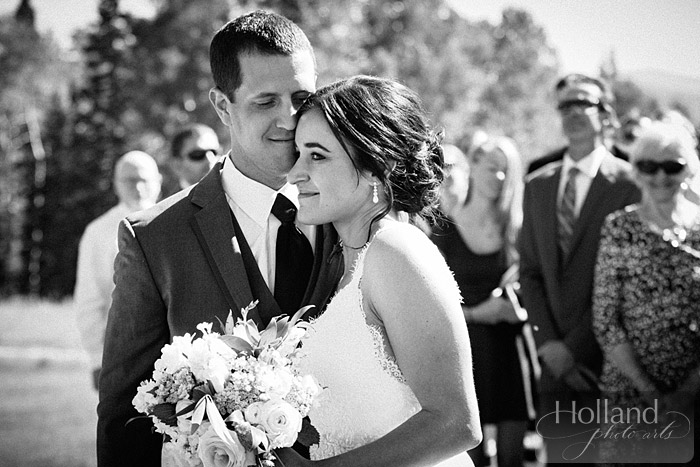 Groom welcomes his bride during ceremony at L&R's Steamboat Springs wedding
