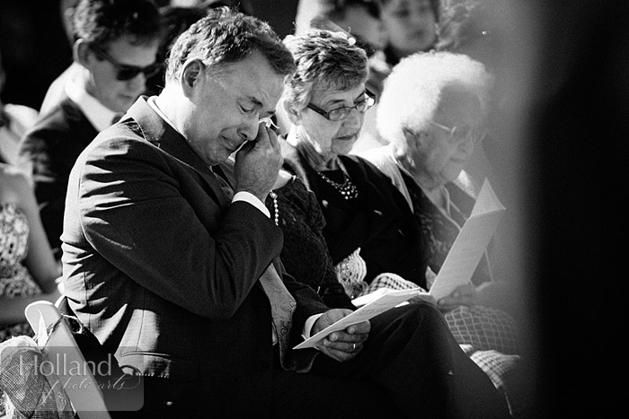 An emotional dad cries during ceremony at L&R's Steamboat Springs wedding