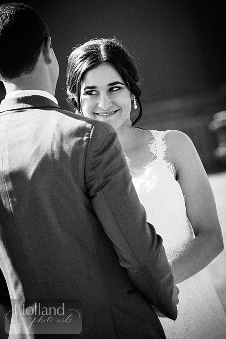 Bride smiles during ceremony at L&R's Steamboat Springs wedding