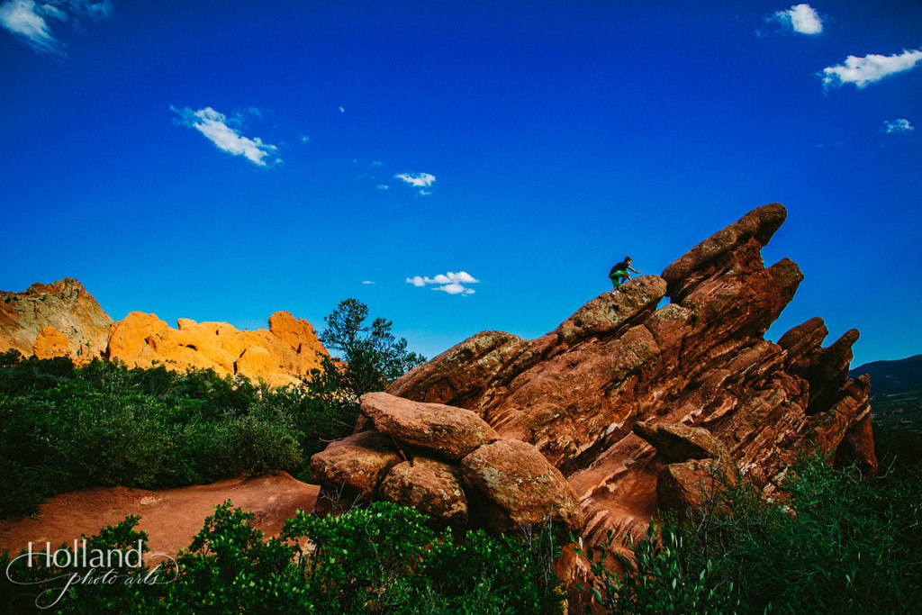 A child climbs a rock at Garden of the Gods