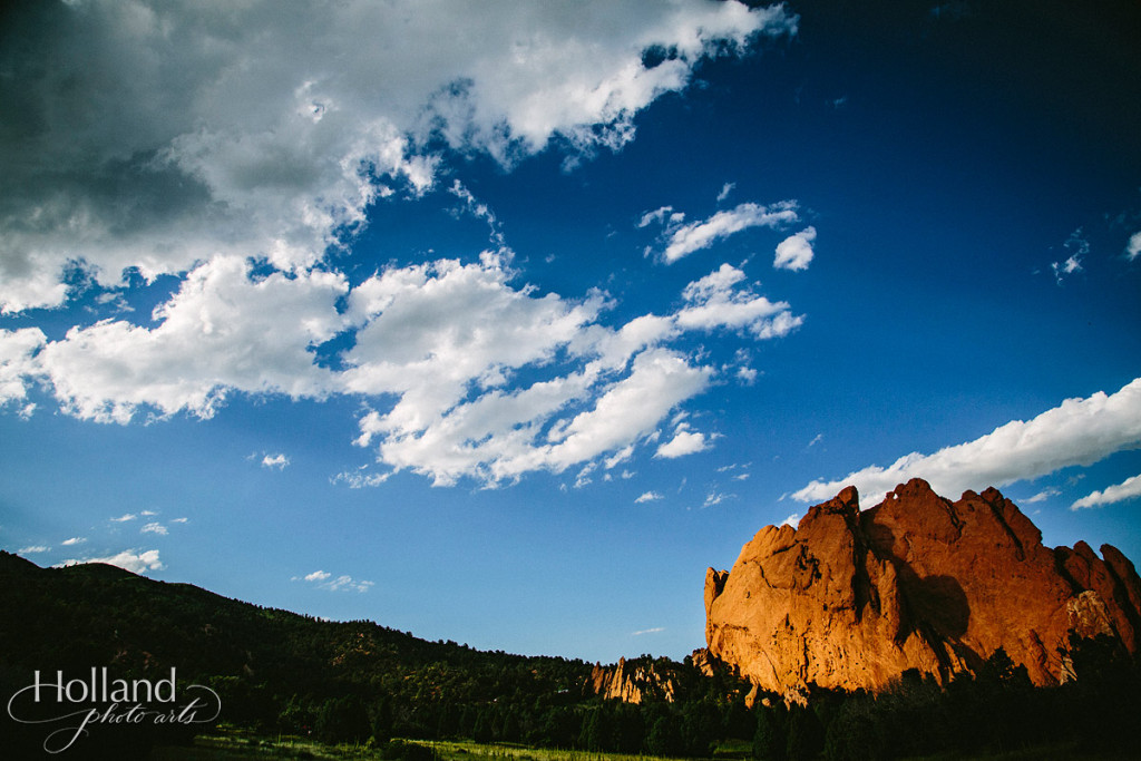Late afternoon sun glows on rock cliffs at Garden of the Gods