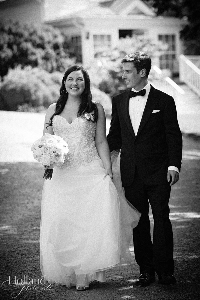 Black and white of K&A walking on their wedding day at Clifton Inn
