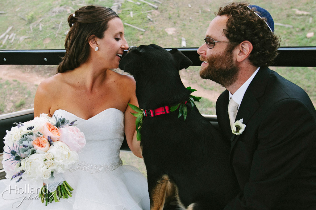 Bride and groom with dog on gondola ride at Vail on way to wedding deck