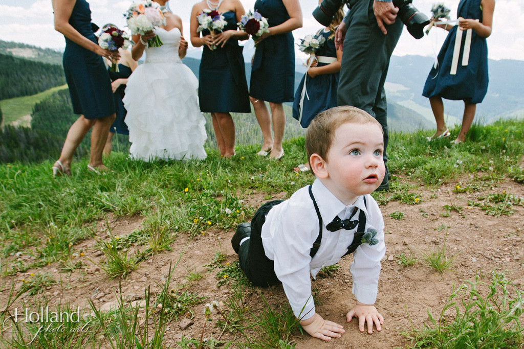 Ring bearer with bridesmaids in background at Vail wedding deck