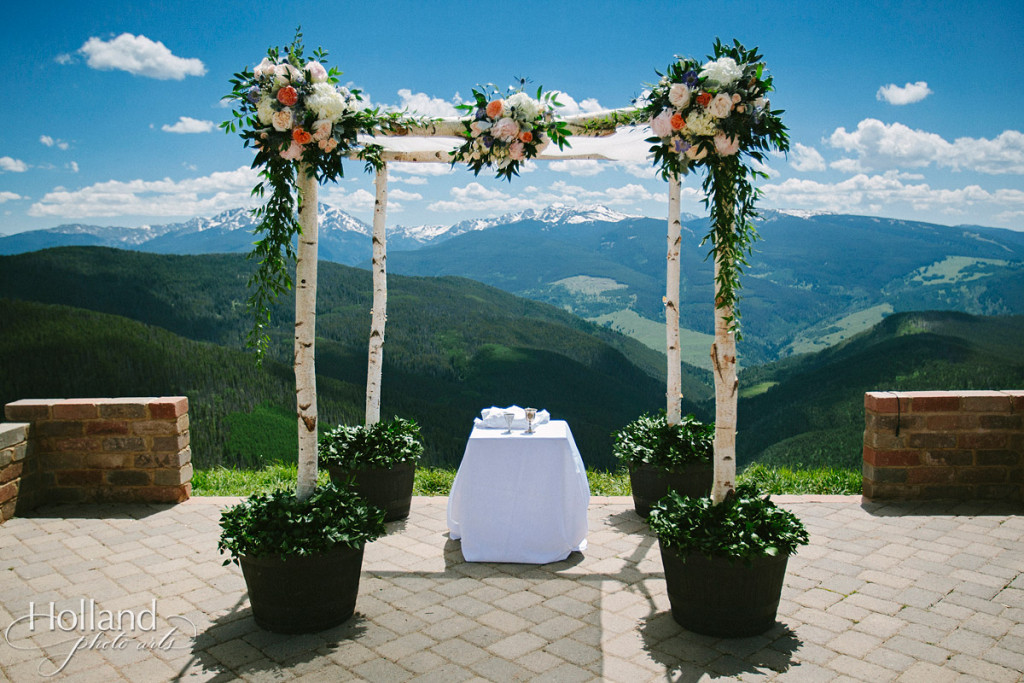 Huppah with flowers and aspen branches at Vail wedding deck for Jewish wedding