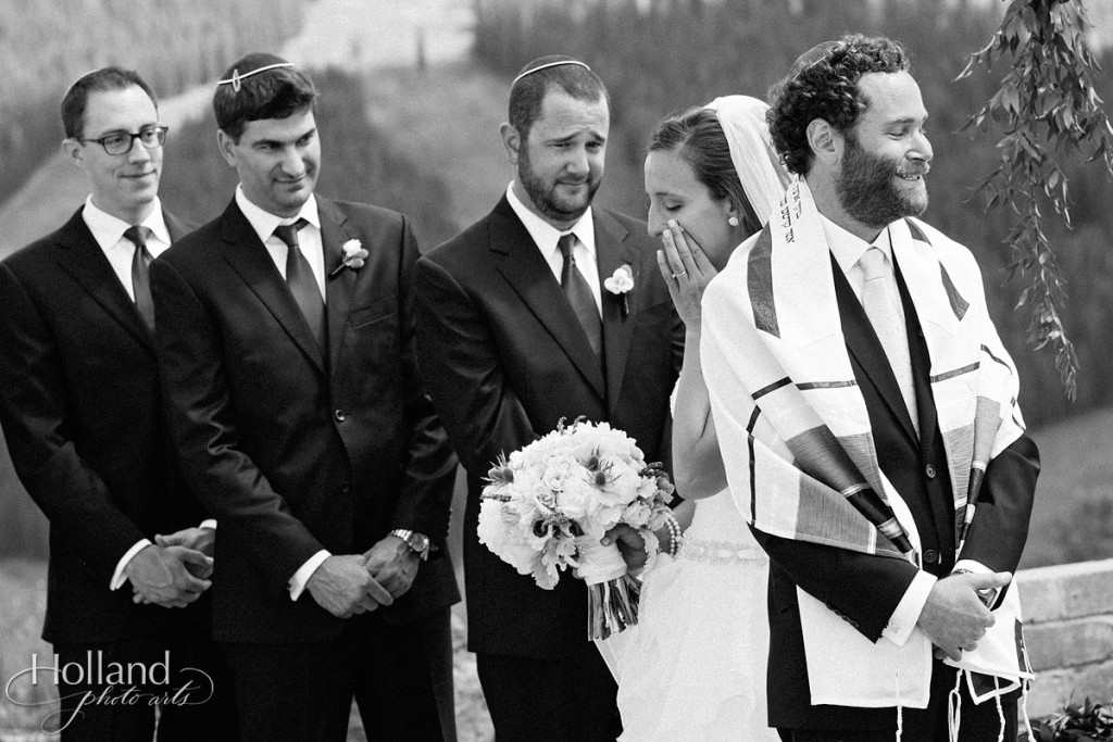 Bride sheds tear as she circles groom during Jewish wedding at Vail wedding deck