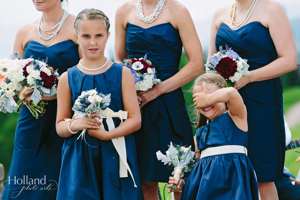 Flower girls appear bored during Jewish ceremony at Vail wedding deck
