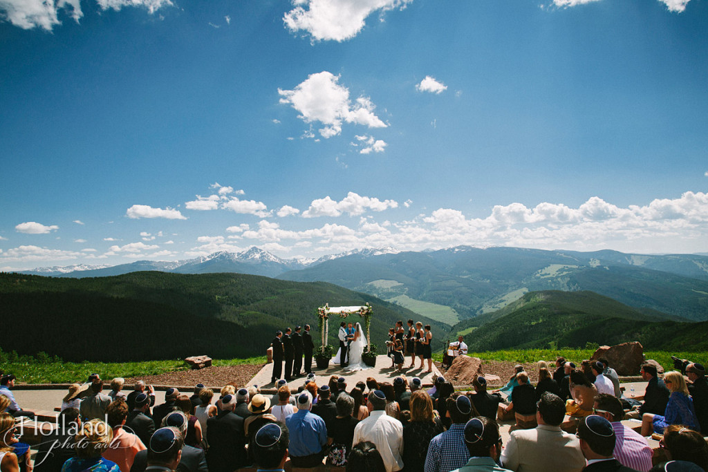Expansive view of rocky mountains during Jewish ceremony at Vail wedding deck