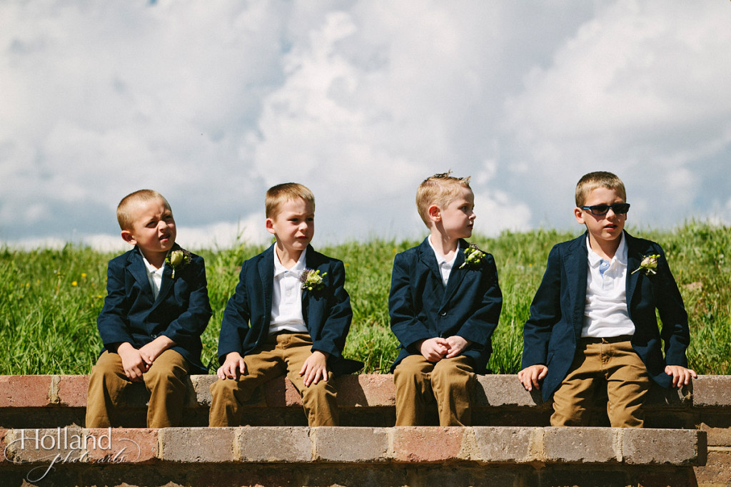 Young boys wait for ceremony at Vail wedding deck