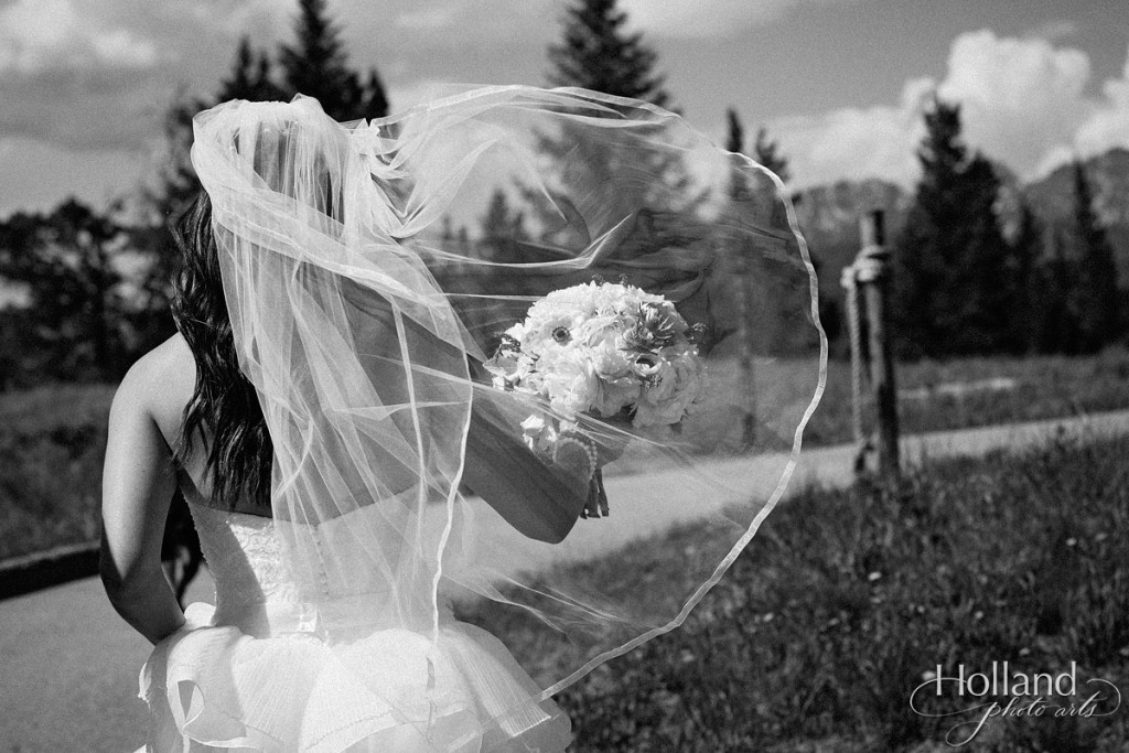Bride's vail flies in wind at Vail wedding deck