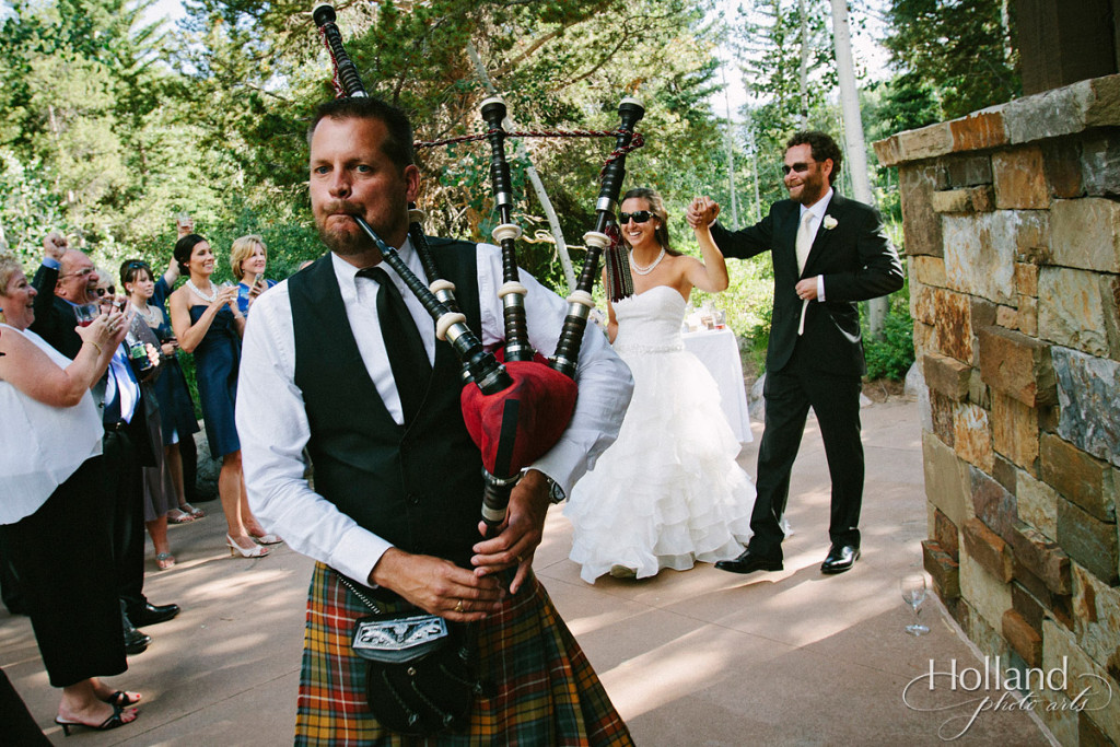 Bagpiper pipes in bride and groom at wedding reception at Donovan Pavillion