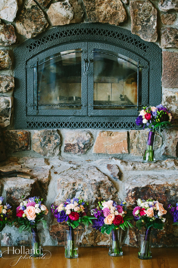 Wedding day flowers against stone fireplace