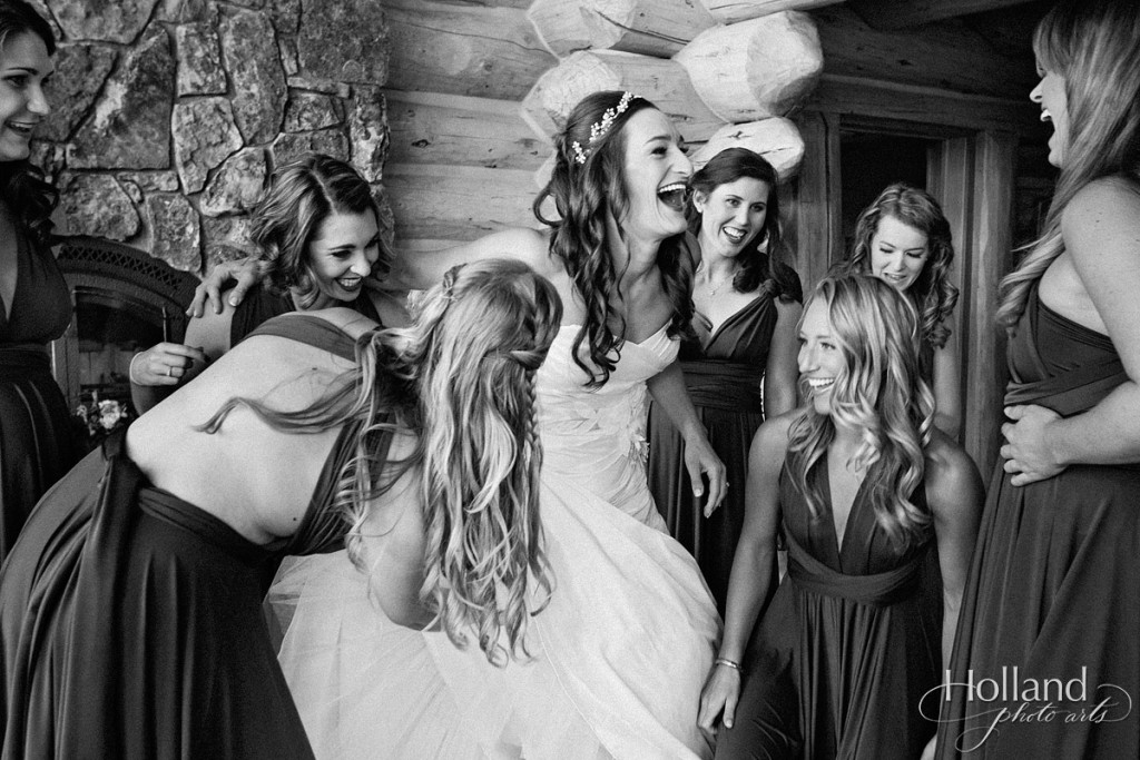Bride and bridesmaids laugh