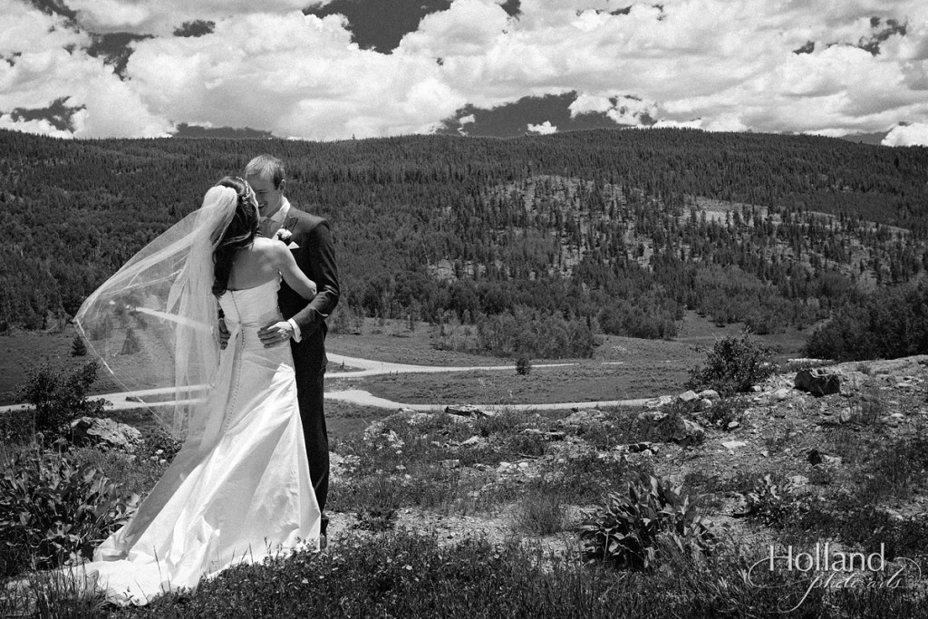 Bride and groom see each other against mountain backdrop