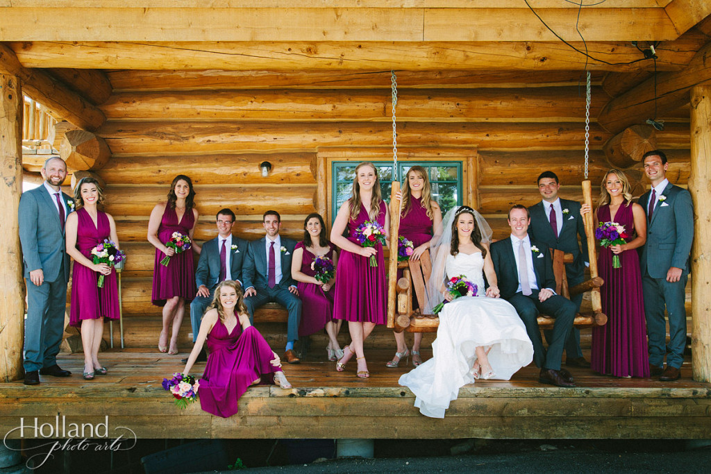 Wedding party portrait on porch of rustic cabin