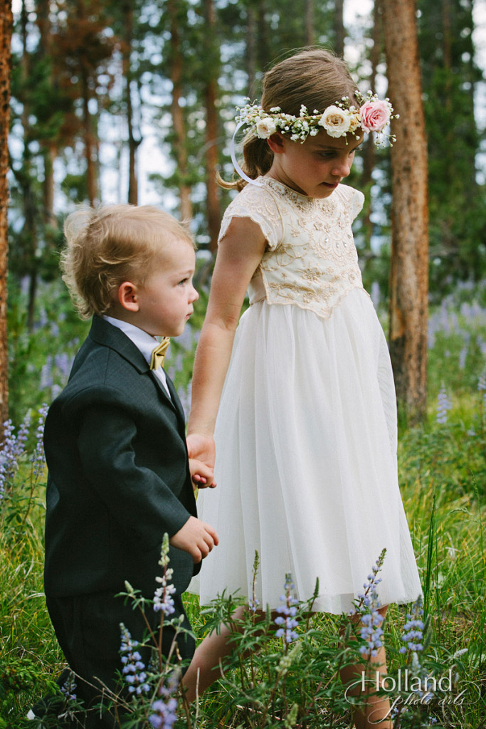 Flower girl and ring bearer in walk in woods