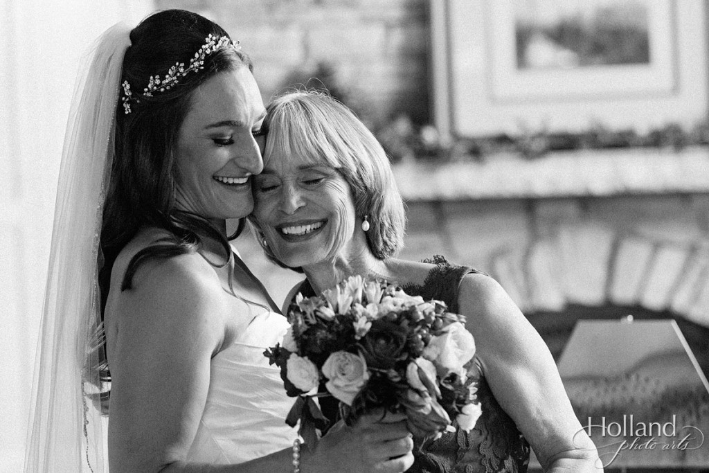 Bride and mom share tender moment following wedding ceremony