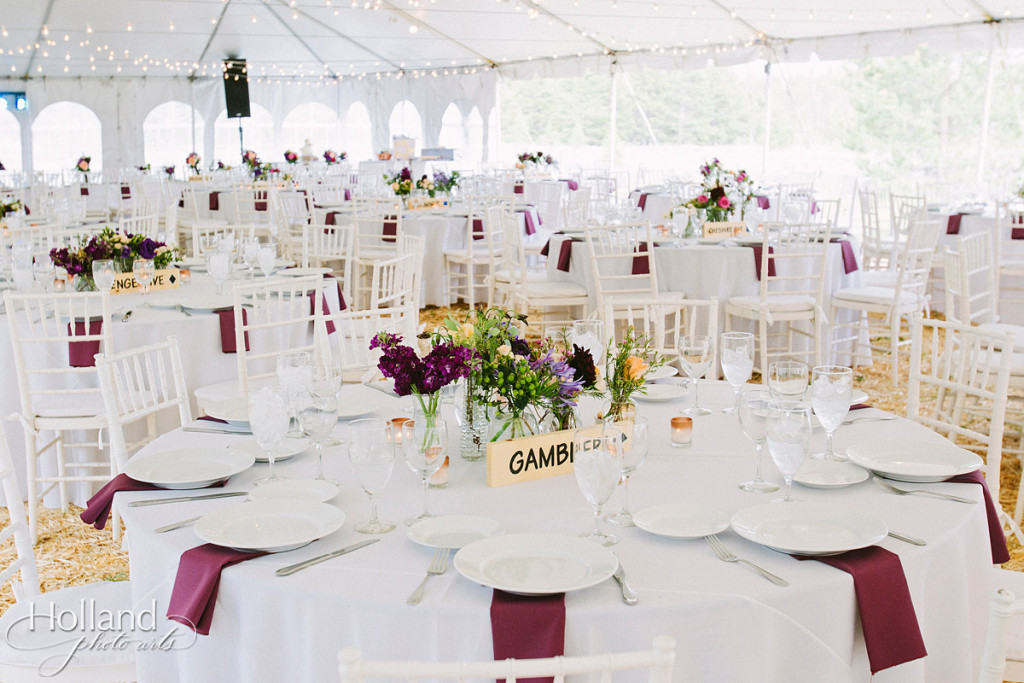 Circular tables with colorful flowers and purple napkins