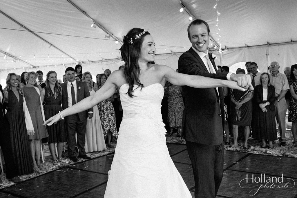 First dance as bride and groom laugh