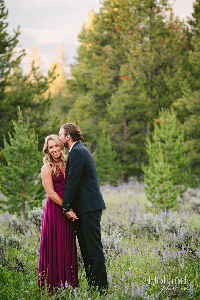 Bridesmaid and boyfriend share tender moment in field