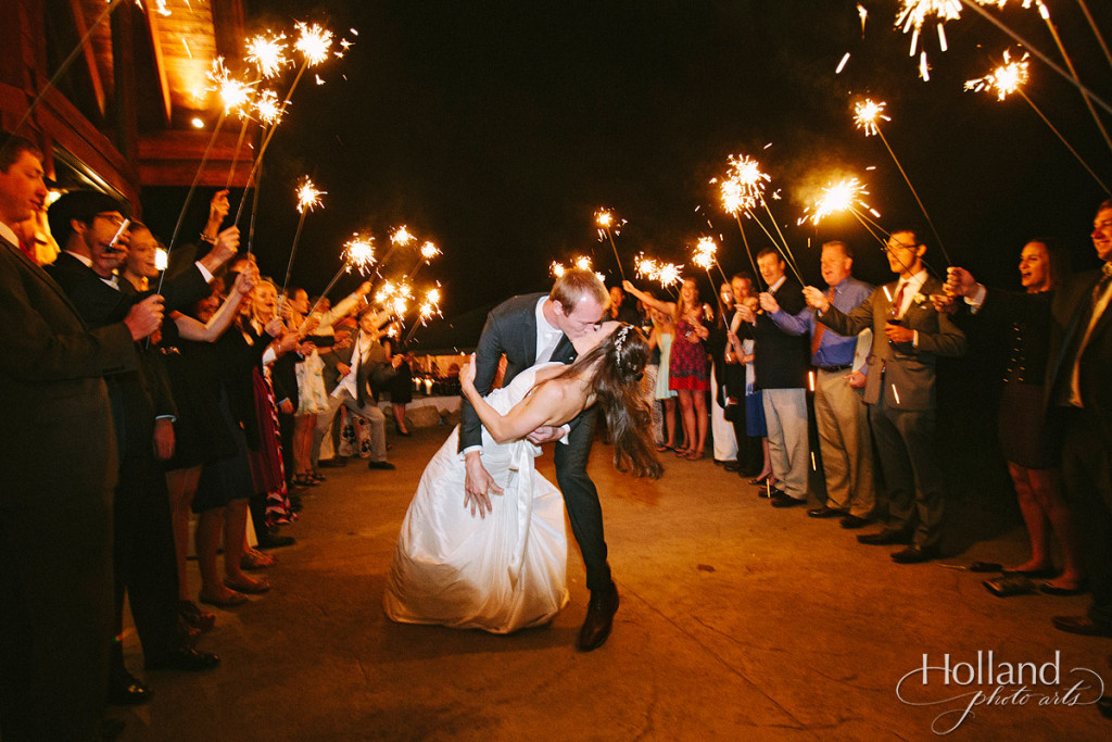 Sparkler departure for wedding couple at base of Rocky mountains